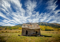 log cabin sky clouds fall mountain house old