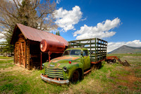 old green farm truck cabin summer