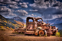 fall rusted truck Crested Butte Mountain clouds