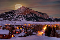 composite photo of moon rising over crested butte mountain