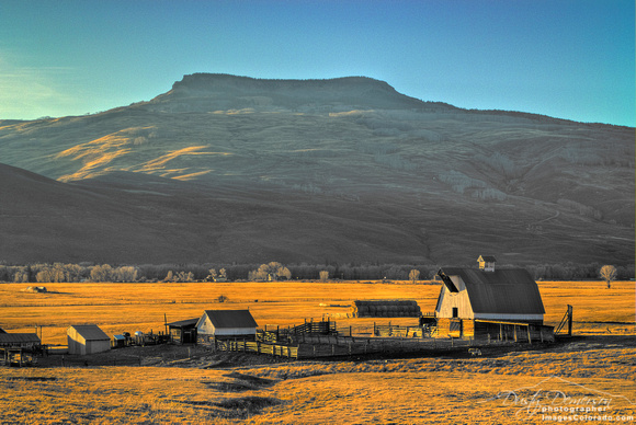 colorado stock photography - sunset light on barn