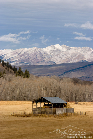 colorado stock photography - hay shed and mountains